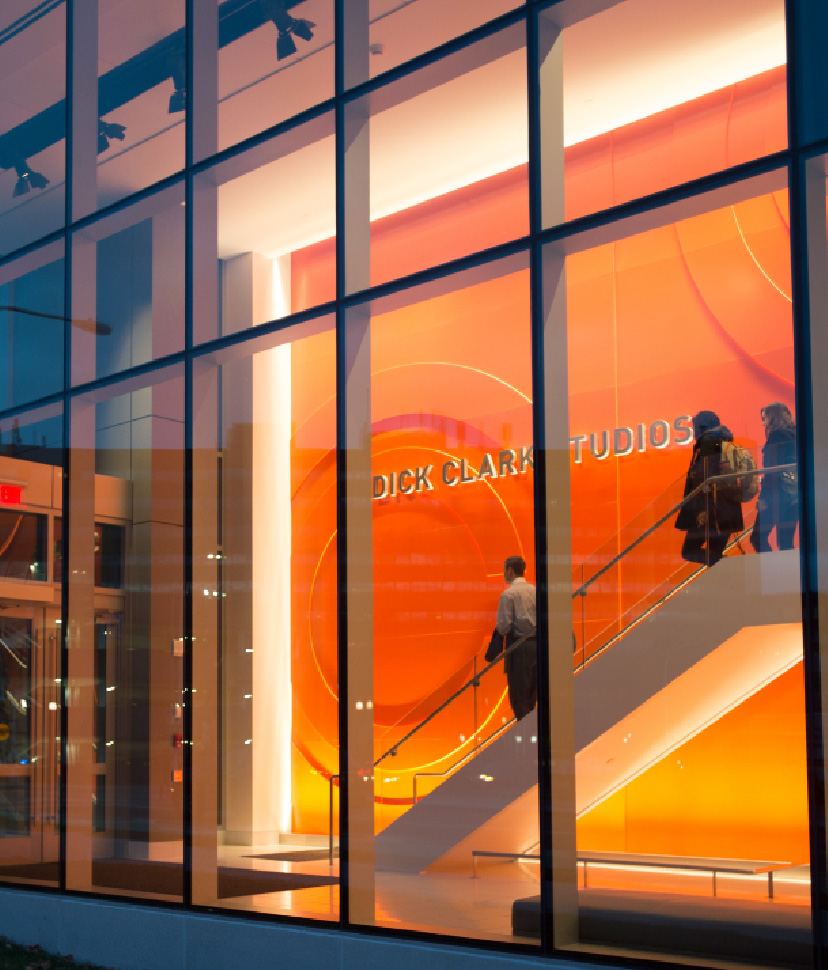 Students descending stairs in Dick Clark Studios entrance at S.I. Newhouse School